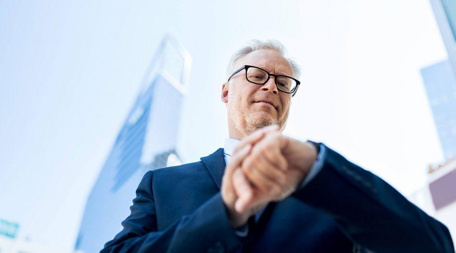 senior-businessman-checking-time-on-his-PGPN5MF(1)
